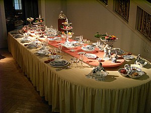 Table (furniture) - A formally laid table, set with a dinner service