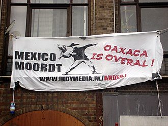 Independent Media Center - Indymedia banner in the Netherlands protesting the Oaxaca shootings