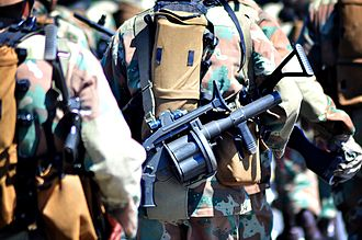 Milkor MGL - A South African soldier equipped with a Milkor Y2 MKI MGL. Variants have been in South African Army service since 1983