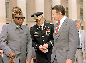 Abacost - Mobutu wearing an abacost (at left) in 1983.
