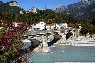 Moggio Udinese - Bridge across the Fella River with San Gallo Abbey