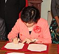 Ms Xu Lin, Director, Confucius Institute, at a signing ceremony in London, 17 April 2012 of the agreement between Confucius Institute and Bangor University (cropped).jpg