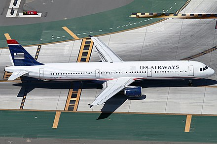 The A320's overwing exits were replaced by doors in front of and behind the wings N162UW (45250787704).jpg