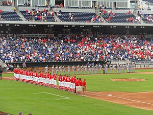 Nebraska Cornhuskers baseball - Nebraska Cornhuskers and Creighton Bluejays baseball teams lined up for the national anthem at TD Ameritrade Park in 2011