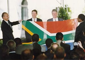 Flag of South Africa - South African Ambassador Harry Schwarz presenting the new flag to the president of the United States, Bill Clinton, in May 1994.