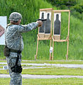 New York Guard Staff Sgt. Joseph Dee fires an M9 pistol.JPG