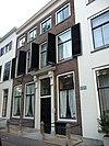 foto van Pand met tussenlid met keuken, gang en een tweede trappehuis, voorhuis en achterhuis