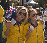 Nina Curtis and Olivia Price at the Welcome Home parade in Sydney.jpg