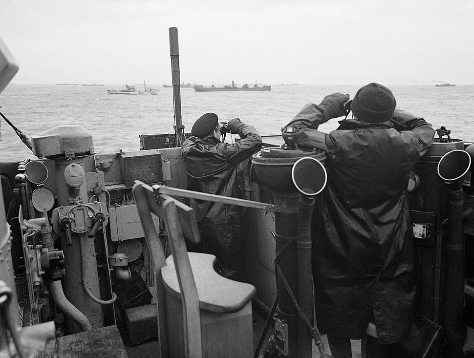 Officers on the bridge of a destroyer, escorting a large convoy of ships keep a sharp look out for attacking enemy submarines during the Battle of the Atlantic, October 1941. A5667