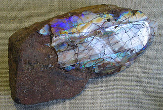 Trachyte - A polished opal on trachyte