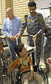 Paratroopers, National Police distribute wheelchairs in 9 Nissan DVIDS181359.jpg
