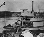 Passengers walking onto the deck of the S.S Peace River, 1913.jpg