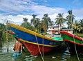 Pescador y botes, Juanchaco.jpg