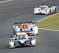 Peugeot 908 and two Lola-Aston Martins.jpg