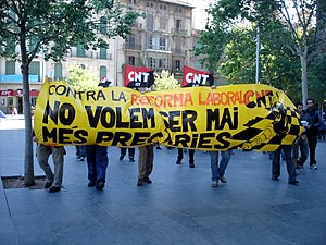 Confederación Nacional del Trabajo - CNT militants carrying a banner written in Catalan.