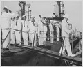 Photograph of President Truman receiving the salute of the crew as he leaves the U.S.S. REQUIN following his... - NARA - 200491.tif