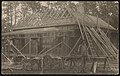 Photograph showing a house under construction and worker standing at site, probably in Alabama LCCN2015652117.jpg