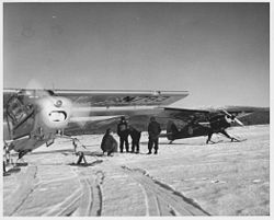 Plane crew in front of plane history photo.jpg