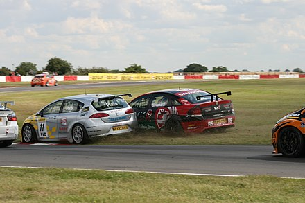 Championship contenders Jason Plato (SEAT) and Fabrizio Giovanardi (Vauxhall) collide during a BTCC race at Snetterton in July 2007. The BTCC is known for being a high-contact series. Plato + Giovanardi Snetterton 2007.jpg
