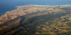 Point Conception - Point Conception and the Gaviota Coast from the air, looking SW. Lighthouse is visible in blowup (click) at top left center. To left (west) is Government Point, which partly encloses Cojo Bay. The Santa Ynez Mountains extend east (left) towards Santa Barbara.