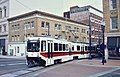 Portland Bombardier LRV turning at 11th & Morrison (1987).jpg