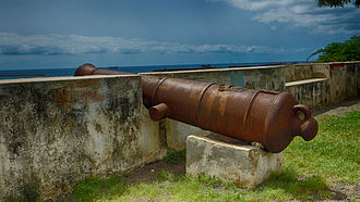 Praia - Portuguese cannon barrel, with coat of arms, at Praia, Cape Verde