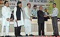 Pranab Mukherjee presenting the National Award for Teachers-2012 to Shri Ibrahimbhai Bachubhai Kureshi, Gujarat, on the occasion of the 'Teachers Day', in New Delhi. The Union Minister for Human Resource Development.jpg