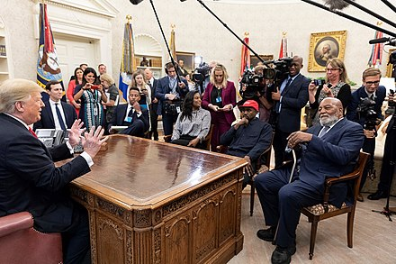 President Donald Trump and Kanye West in the Oval Office, on October 11, 2018 President Donald Trump and Kanye West 2018-10-11.jpg