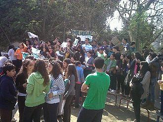 Lycée Français du Caire - Students protesting, holding up signs demanding the return of their math teacher