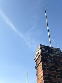 a rabbit ear indoor antenna weatherproofed and installed outdoors