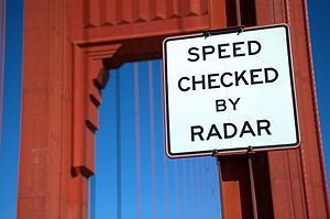 English: Radar warning road sign in front of t...