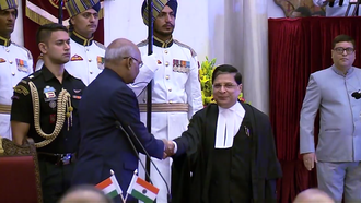 A presidential aide-de-camp can be seen to the left of President Ram Nath Kovind, who has just administered the oath of office to Indian chief justice Dipak Misra on 28 August 2017. Ram Nath Kovind with Dipak Mishra.png