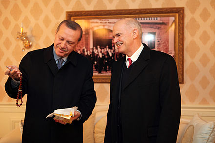 Erdogan with Greek Prime Minister George Papandreou. Recep Tayyip Erdogan and George Papandreou, Erzurum January 2011 08.jpg