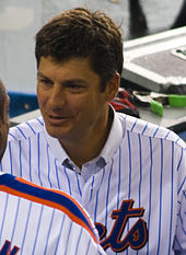 Robin Ventura, wearing a blue pinstripe jersey with the words METS partially cut off, converses with a fellow player