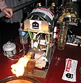 Robot mixing flaming drinks of Bacardi 151 and Kahlúa.jpg