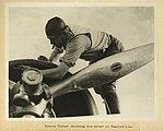 Roscoe Turner checking his plane engine at Charleville 1934 (24790587842).jpg