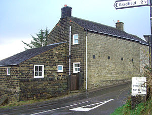 Brightholmlee - Rose Cottage at the junction of Thorne House Lane and Brightholmlee Road, the 19th century milepost is bottom right.