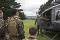 Royal New Zealand Air Force Sgt. Geoff Cameron, right, a helicopter crewman with the No. 3 Squadron, briefs U.S. Marines on safety procedures for the UH-1H Iroquois helicopter in preparation for exercise 131104-M-EP759-073.jpg
