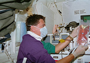 STS-70 - Mission Specialist Donald Thomas works with Bioreactor samples.