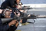 Sailor fires an M16 rifle during a small arms qualification on the flight deck of USS Green Bay. (28318783333).jpg