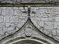 Sainte-Innocence église porche blason.jpg