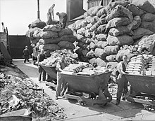 Bagged aluminium supplies piled up before carts of aluminium metal