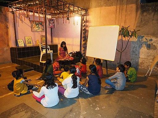 Seema teaching music, song, meditation, English to underprivileged children in Delhi