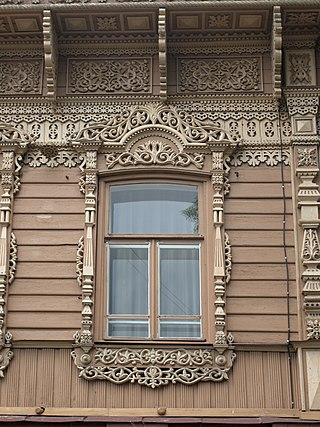 Example of wood carving in Tomsk wooden architecture Shishkov House Window Carving.jpg