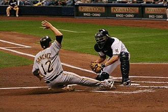 Slide (baseball) - A catcher attempts to block a player from reaching home plate