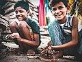 Small boys making ganpati idol.jpg