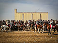 Soviet Bread Factory towering over Nowruz Buzkashi Match in Mazar (5778805960).jpg