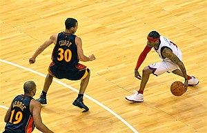 Stephen Curry - Curry defends against Allen Iverson in 2009.