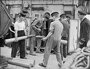 Storing 4-inch ammunition on HMS Widgeon 1943 IWM A 18542