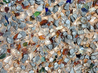 "Stucco - Rock dash stucco used as an exterior coating on a house on Canada's west coast.  The chips of quartz, stone, and colored glass measure approx. 3-6 mm (1/8"" - 1/4"")."